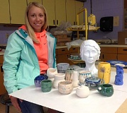CONTRIBUTED PHOTO - May Estacada High art student of the month, senior Carly Sutherland, shows off some of the clay and ceramic works she is known for.
