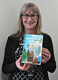 ESTACADA NEWS PHOTO: ISABEL GAUTSCHI - Local author Martha Pyne Amick smiles over a copy of her new children's chapter book: 'The Adventures of Sadie and Rose: Mia the Pony.' The book was illustrated by local artist, Nina Bradford.