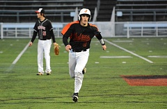 JOHN WILLIAM HOWARD - Scappoose senior Robby Backus is batted to third base in the bottom of the seventh inning on Tuesday at Hillsboro Stadium. Backus scored on a wild pitch moments later, winning the game for the Indians.