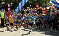 REVIEW PHOTO: VERN UYETAKE - Youngsters make a run for it at the start of the Kids' Dash, one of three events that make up the Lake Run.