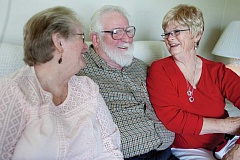 KEVIN SPERL - Peter Pine, center, of Galloway, NJ, visits with his Aunt, Charleene Harmon, right, at her home in Prineville. Pine and his wife, Judy, left, traveled across the country recently to meet Peter's birth family.