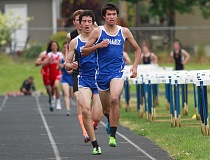 TIMES PHOTO: MILES VANCE - Valley Catholic's Wilder Boyden and Ben Davidson run to a 1-2 finish in the boys 1,500 meters during the Cowapa League District track and field meet at Banks High School on Friday, May 15.