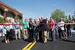 TIMES PHOTO: JAIME VALDEZ - Mayor Denny Doyle, members of the Biggi family and others cut a ceremonial ribbon Monday to celebrate the opening of Southwest Rose Biggi Drive. The newly extended street helps connect motorists between Canyon Road and Hall Boulevard near The Round.