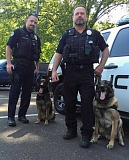 RAY HUGHEY - Veteran Canby Police K-9 Freddy, at right with handler Sgt. Tim Warren, is retirinig and ready to start his Canby career is K-9 Cavo, with handler Chris Koehnke.