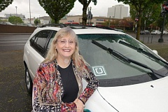 TRIBUNE PHOTO: JOSEPH GALLIVAN - Uber drivers like Lexus owner Amy Hall will be affected new insurance requirements on Uber and Lyft to cover private drivers while they are connected to those transportation networks.