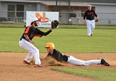 JOHN WILLIAM HOWARD - St. Helens' Quintin Galvin slides into second base as Scappoose senior Justin Hering reaches for the tag-out. Galvin finished with three hits and three RBIs as St. Helens won 5-0.