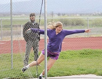 JEFF WILSON/THE PIONEER - Culver coach Mike Dove looks on as Catylynn Duff works on her discus technique. The freshman qualified for state in two events, including the shot put.