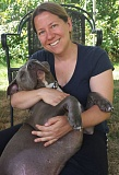 CONTRIBUTED PHOTO - Sage Jensen of Portland enjoys an uber snuggle with Rufus, a rescue pit bull.