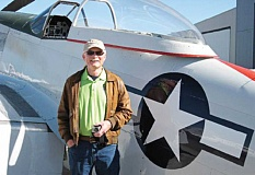 SUBMITTED PHOTO - Bruce Hoyt, of Madars, poses in front of the aircraft before takeoff from the Madras Municipal Airport.