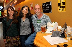 TIDINGS PHOTO: VERN UYETAKE - Russ Axelrod, along with his wife Dede Montgomery and daughter Erin Axelrod, await election results Tuesday night during a party at Cask N Keg.