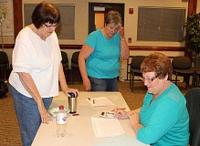 HOLLY M. GILL - From left, Lorelee Dendauw, Ellen McNamee and Lynne Weisen finish up tallying the vote Tuesday evening at the Jefferson County Courthouse Annex.