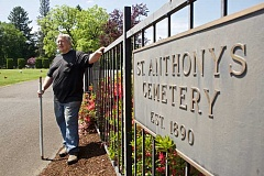 TIMES PHOTO: JAIME VALDEZ - Jim Haberski, cemetery director at St. Anthony Catholic Cemetery, stands at an entrance of the Tigard's Catholic cemetery. The cemetery turned 125 this year.