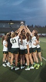 The West Linn girls lacrosse teams holds the state championship trophy in celebration of its 12-10 win over Lake Oswego on Wednesday.