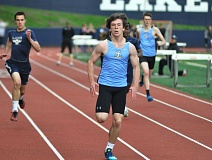 MATTHEW SHERMAN - Above, Lakeridge's Nick Hoddevick cruises to a win in the 400 meters at last week's Civil War meet.