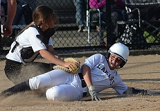 VERN UYETAKE - Lake Oswego's Brionna Gereb is tagged by Lakeridge catcher Kelley Ericson at the plate during the Pacers' 9-5 victory last week.