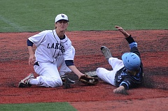 VERN UYETAKE - Lake Oswego shortstop Jake Dukart tries to make a tag at second base during the Lakers' 3-0 victory over Lakeridge at home on Tuesday.