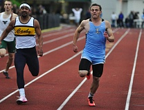 MATTHEW SHERMAN - Lakeridge's Cameron Russell hits the finish line just ahead of Canby's Devon Fortier to win the 200 meters district championship at Canby High School last week. He set a PR in the process and also helped two relays qualify for state.