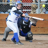 LON AUSTIN/CENTRAL OREGONIAN - Emma Ackley blasts a double in the Cowgirls' 10-inning loss to the Madras White Buffalos on Tuesday. Ackley was 4-4 in the contest with a pair of doubles.