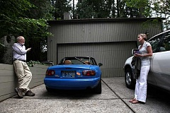 TIMES PHOTO: JAIME VALDEZ - Patrick and Karyn Pecknold stand outside of their Durham home in 2011. The city has seen a 40 percent rise in its population over the last five years, growing to nearly 2,000 residents