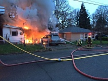 COLUMBIA RIVER FIRE & RESCUE PHOTO - Firefighters respond to the scene of a house fire in west St. Helens on Tuesday, March 10. A 10-year-old boy said Thursday, May 21 that he set the fire.
