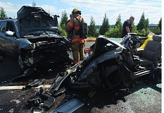 COURTESY OF PF&R: DICK HARRIS - Portland firefighters had to cut a man from his heavily damaged vehicle Monday afternoon, May 25, on Northeast Marine Drive.