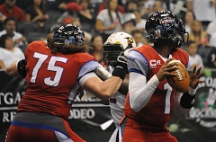 COURTESY: ARENA FOOTBALL LEAGUE - Darrron Thomas (right) drops back to pass for the Portland Thunder in Saturday's road loss at the Orlando Predators.