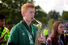 CONNECTION PHOTO: KELSEY O'HALLORAN - Sam Behrens practices marching while playing the saxophone after school at Wilson High.