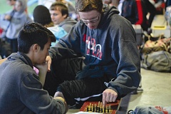 THE OUTLOOK: DAVID BALL - David Douglas senior Josh Kellebrew takes a break in the grandstands playing chess with a teammate during the district championships.