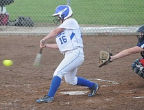 LON AUSTIN/CENTRAL OREGONIAN - Maddie Faust rips a two-run home run in the bottom of the sixth inning to give the Cowgirls a 2-1 victory over the Phoenix Pirates Friday afternoon at Crook County. The win qualified the Cowgirls for the first round of the state playoffs.