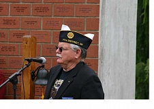 CONTRIBUTED PHOTO: SANDY HUNT, EASOTF PHOTOGRAPHER - Douglas Jamieson, commander of the local chapter of the American Legion, speaks during the Memorial Day Ceremony at the Estacada Veterans Memorial on Monday, May 25.