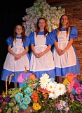 SUBMTTED PHOTO - Pictured from left are Kate Jeffries as Small Alice, Kaiya Shivers as Lead Alice, and Natalya Karnes as Tall Alice.