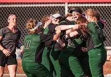 Led by pitcher Cheyenne Vance (black visor), Reynolds celebrates its 8-4 second round playoff victory today over Southridge.