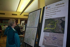 CONNECTION PHOTO: KELSEY O'HALLORAN - Hillsdale resident Carolyn Gassaway examines a map of Southwest Corridor tunnel options during a community forum in May at Wilson High School.