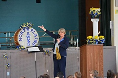 HILLSBORO TRIBUNE PHOTO: KATHY FULLER - North Plains Elementary School principal Karen Murphy introduces one of the speakers during an assembly Thursday afternoon celebrating the schools 100 years.