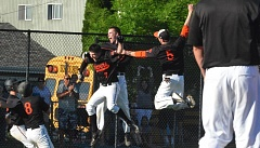 TIMES PHOTO: MATT SINGLEDECKER - Beaverton's Sam Noyer, Casey Cornwell, Rob Lavey and the rest of the Beaver baseball team celebrates Noyers game-winning hit in the second round of the 6A playoffs on Wednesday.