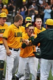 MATTHEW SHERMAN - West Linn's Tim Tawa is mobbed at the plate after hitting a fifth inning home run that gave the Lions their first lead of the game.