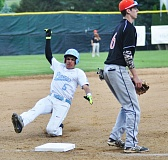 MATTHEW SHERMAN - Jack Daraee slides in safely to third base during Lakeridge's 4-2 win over Sprague Monday. He had a pair of RBI doubles in the game.