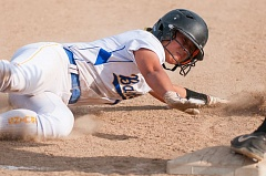 Kaylee Ree slides into third base for Barlow.