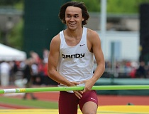 SANDY POST: DAVID BALL - Sandys Kaden Walker shares a smile with a group of Pioneer supporters in the south grandstands after clearing 14 feet on his first try.