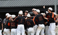 JOHN WILLIAM HOWARD - Scappoose celebrates as one, moments after closing out the bottom of the seventh inning to beat Gladstone 2-0 for a spot in Saturday's state title game in Salem.