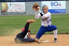 THE OUTLOOK: DAVID BALL - Barlows Meagan Bratcher looks to the field umpire for a call after a close play at second base, as Valeti Fifita dives back to the bag in the eighth inning.