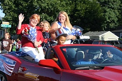 PEGGY SAVAGE - Last year's grand marshall waves to the crowd as the Kiddies Parade winds through downtown Molalla streets.