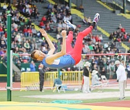 JEFF WILSON/THE PIONEER - Madras high jumper Brent Sullivan goes up and over the bar during Saturday's state track competition at Hayward Field. Sullivan would tie a personal best at 6-4 and win the event.