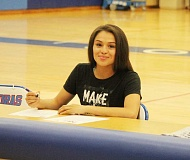 JEFF WILSON/THE PIONEER - Madras senior Mariah Stacona signs her national letter of intent to play basketball at Northwest University last week. Located in Kirkland, Wash., Northwest is an NAIA school that has become very competetive over the last two years.