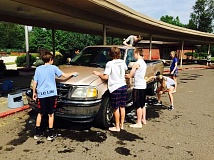 SUBMITTED PHOTO - Lake Oswego Junior High's National Honor Society students raised $1,000 for the Lake Oswego Schools Foundation at a car wash Saturday at LOJ.