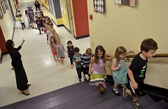 TIDINGS PHOTO: VERN UYETAKE - Next fall's kindergarteners file through the halls of Sunset Primay School en route to the music room.