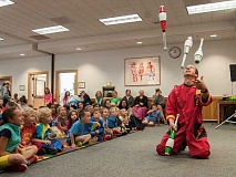 SPOKESMAN FILE PHOTO - Juggler Rhys Thomas entertains an avid crowd at an event during the 2014 summer reading program at the Wilsonville Public Library. Fun events featuring jugglers, musicians and storytellers are scheduled for Thursdays at the library, starting June 18 through July 30.