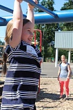 SPOKESMAN PHOTO: KATE HOOTS - Madison Montalvan, 5, tests her strength on the monkey bars at Boeckman Creek Primary School June 5. She and her future classmates were taking a peek at the school they will attend as kindergarteners next fall.