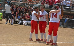 TIMES PHOTO: MATT SINGLEDECKER - Westview softball players Katie Whetstine, Lexi Patino, Katie Gilley and Shannon Daly share a final embrace after the Wildcats were beaten 10-0 in the Class 6A state championship game on Saturday.
