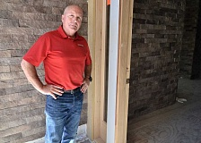 REVIEW PHOTO: VERN UYETAKE - Mark Stephens, co-owner of Stephens Homes, shows off some of the features of the Mid-Century Modern home he's building for the NW Natural Street of Dreams, including exterior stone work that continues to the interior.